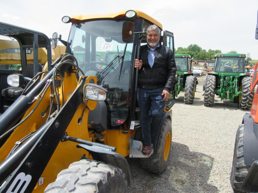 CN Metal's Calvin Nissley Jr. considers a bid on this JCB 407 wheel loader.