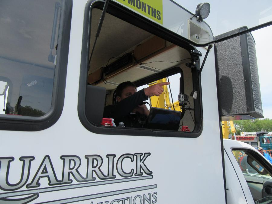 Quarrick Equipment & Auctions' Mike Quarrick keeps the bidding moving along at a fast clip.