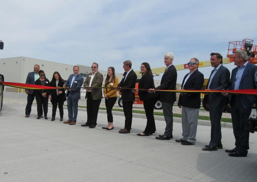 Ohio Machinery Co. President and Owner Ken Taylor (fifth from L) prepares to cut the ribbon in celebration of the new campus.
