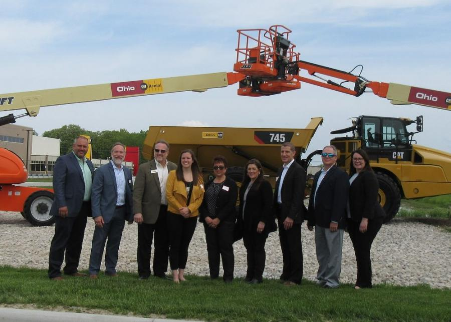 Ken Taylor (third from L) and daughter Gillian Taylor (fourth from L) are flanked by the Ohio Machinery management team at the ribbon-cutting ceremony.