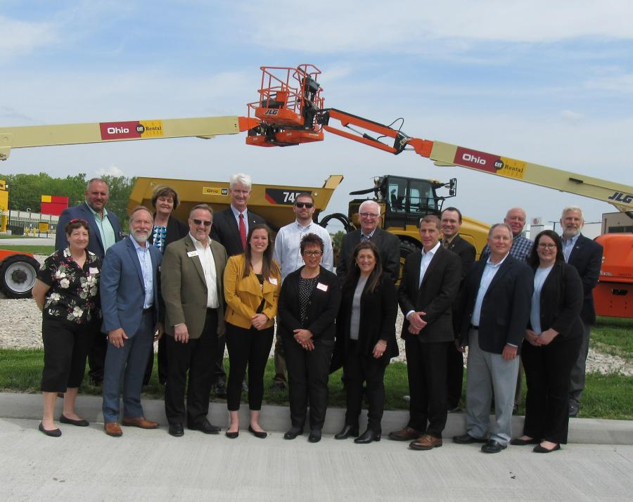 Perrysburg and Wood County officials join Ken Taylor (first row, third from L) and daughter Gillian Taylor (first row, fourth from L) in celebrating the new facility.