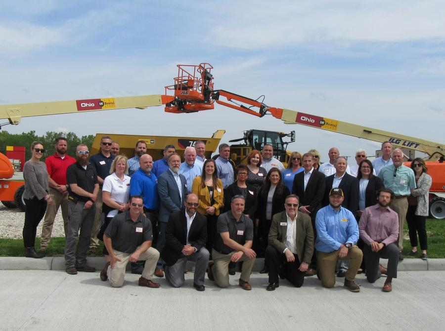 Ken Taylor (first row, third from R) and daughter Gillian Taylor (second row, fifth from L) are surrounded by the company's appreciative employees at the ribbon-cutting ceremony.