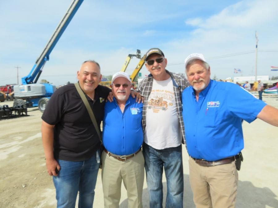 """(L-R) are Juan Carlos Gonzalez Muller, president of Alex Lyon & Son, Mexico; Jack Lyon, president and CEO, Alex Lyon & Son; Don Schwalbach of Elderon Truck and Equipment; and Mike Powers of Alex Lyon & Son. Jack and Mike were celebrating their """"50th"""" birthdays at the Racine auction."""