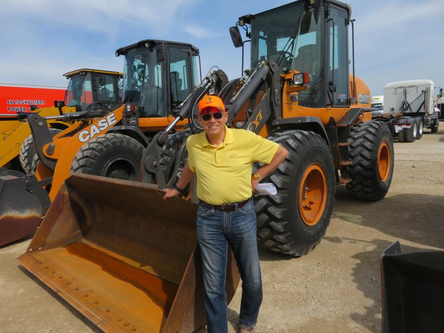Dean Shaw, used equipment manager of Miller-Bradford and Risberg Inc., looks over the Case wheel loaders.
