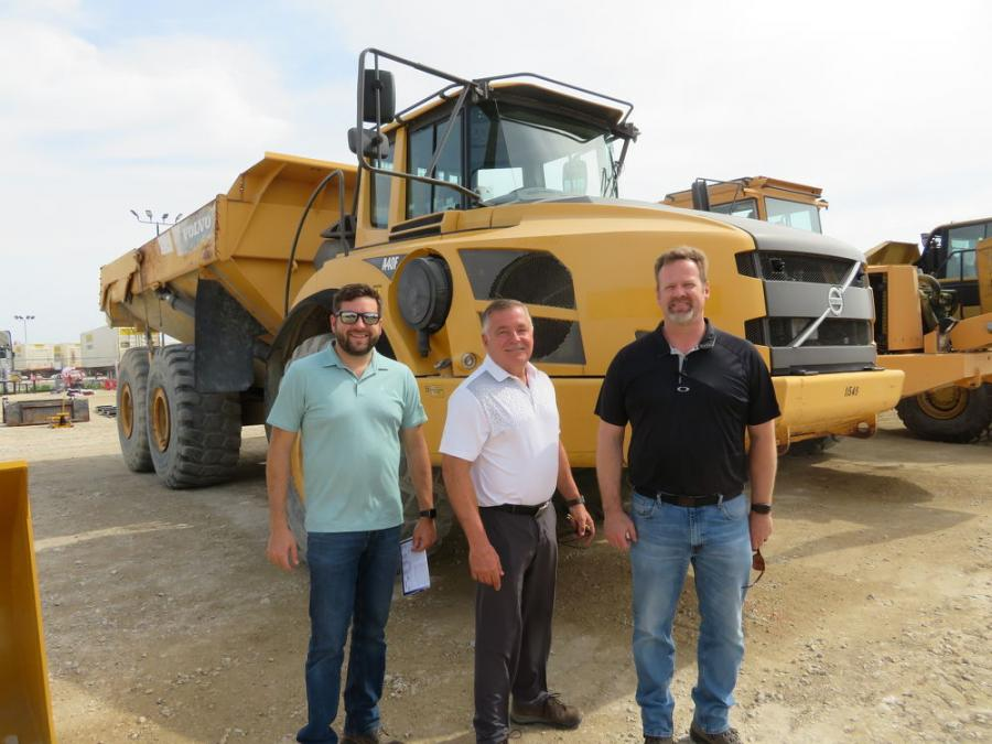 In front of this Volvo A40F articulated haul truck (L-R) are Daniel Oaks; Dan Oaks, president; and Kevin Hokanson, all of A.W. Oaks and Son of Racine, Wis.