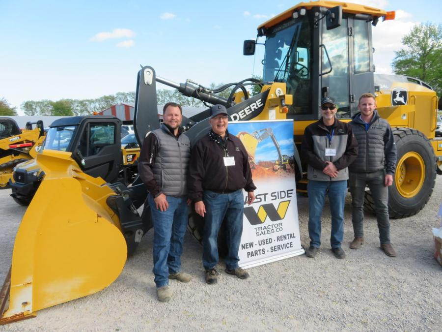 West Side Tractor Sales Co. bought in a John Deere 524L wheel loader to display. Representing West Side (L-R) are Mark Gronkiewicz, Tom Stern (retired sales manager), Wayne Massad and Adam Degaetano.
