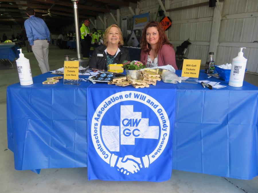 Mary Metz (L), CAWGC executive director, and Karri Lane, plan room coordinator, also of CAWGC, welcome everyone to the Meet & Greet Expo.