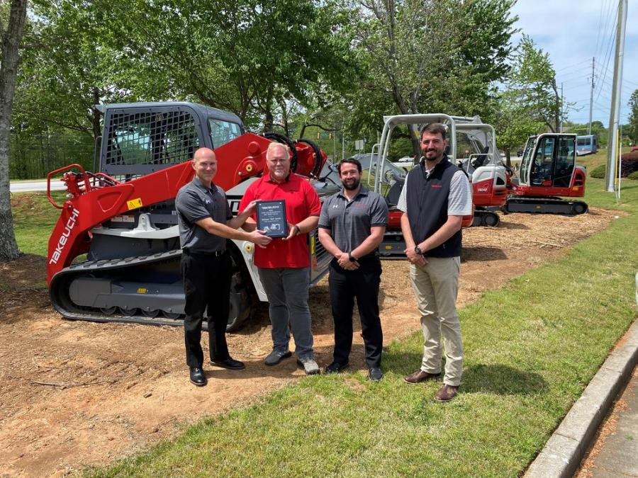 (L-R): John Vranches of Takeuchi presents Bill Smith of Cobb County Tractor with his award for being Takeuchi's top dealer salesperson in 2020 while Takeuchi's Steve DePriest and Austin Smith look on.