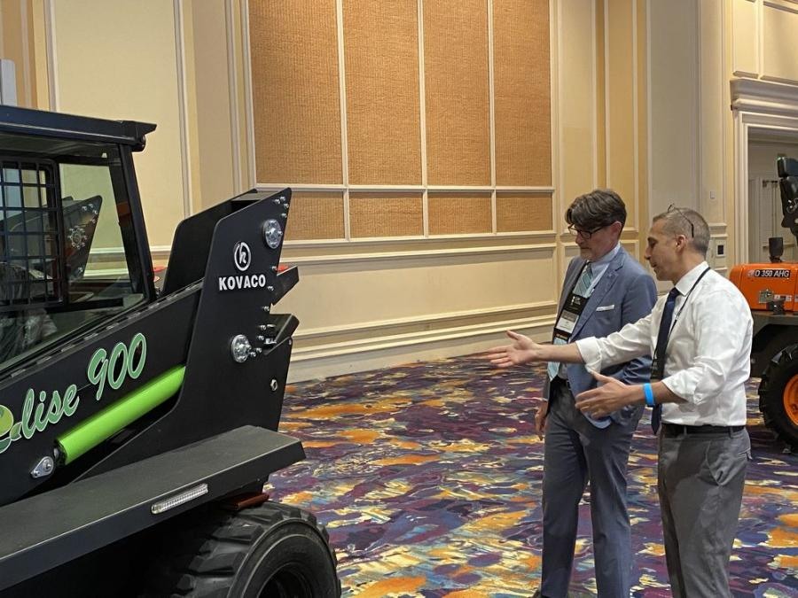 Checking out the first electric skid steer manufactured by Kovaco is Jeff Scott (L) of  Scott Machinery in Salt Lake City, Utah, and Joe Schainasi of Kovaco.