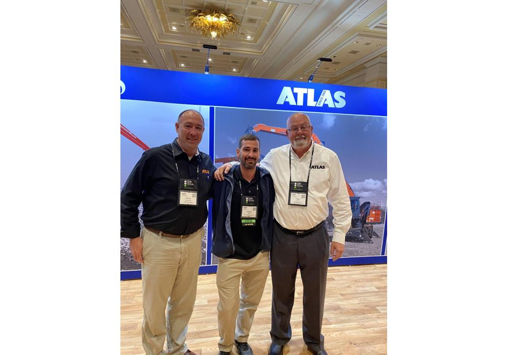 Atlas is expanding its distribution of purpose built scrap handling machines in North America.  (L-R) are Chuck Priggmeier, service manager of SMH Group; Jeremy Clark, technician of the year of Linder Industrial Machinery; and Tom Hickson, general manager  of SMH Group. The SMH Group is the U.S. distribtor of Atlas material handlers.