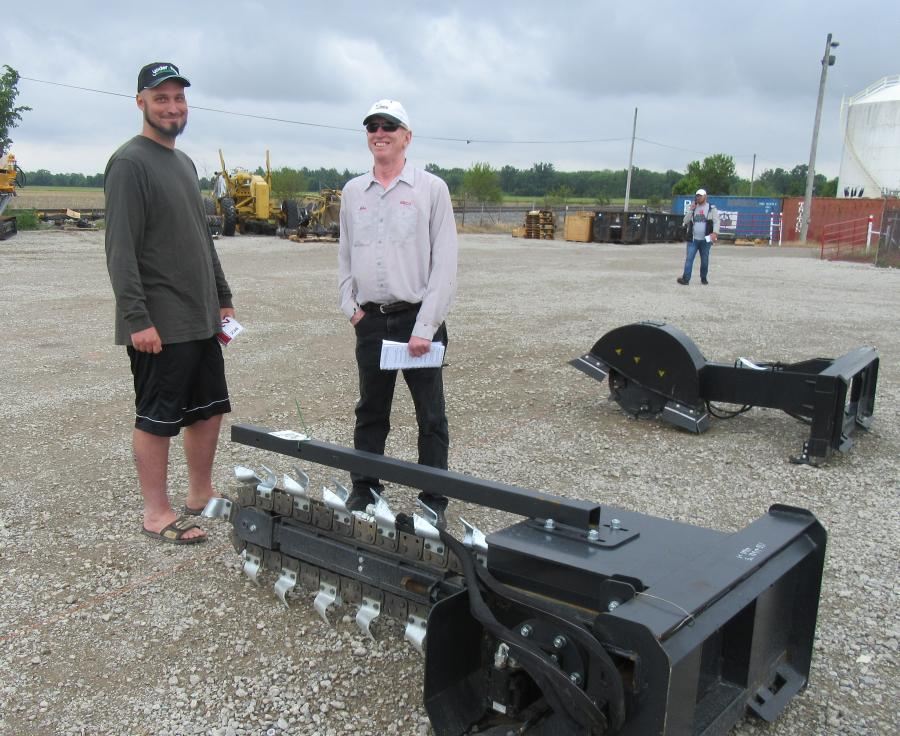 Don Taylor (L) of Taylor Equipment Sales discussed trencher attachments with Mike Miller of Miller Property Management.