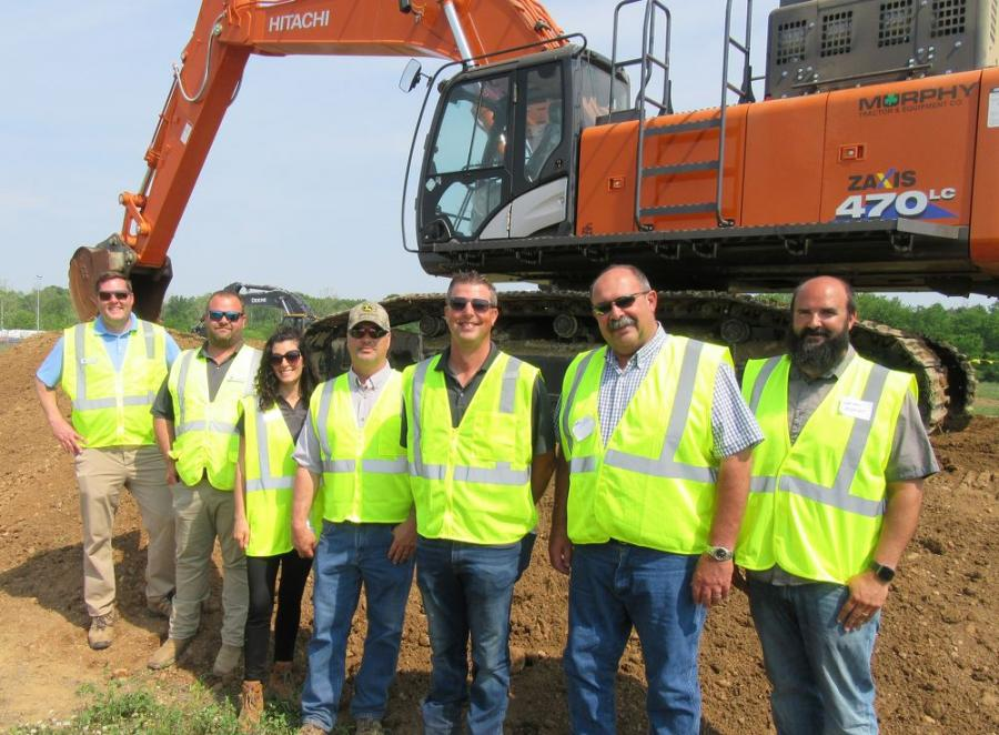 (L-R): John Deere factory representatives Alex Anhalt, Shad Wood and Kasey Kelly, joined Murphy Tractor & Equipment's John Fork and Ryan Heckel to speak with Mike Anderzack and Nathan Marlatt of Anderzack-Pitzen Construction, based in Metamora, Ohio, about the lineup of excavators at the event.