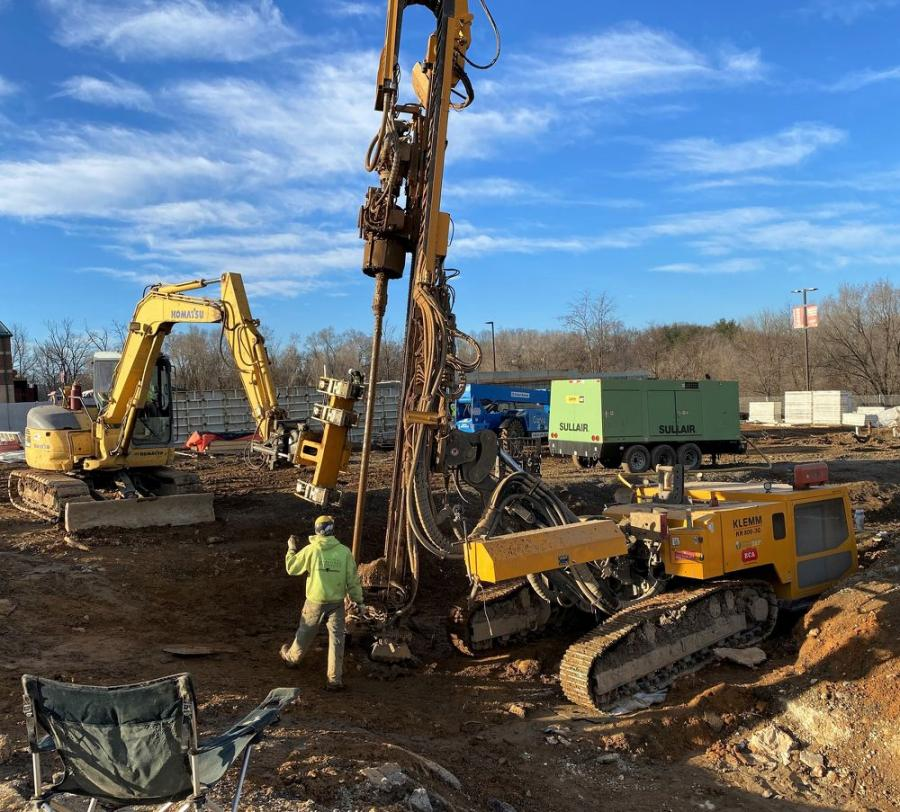 Technical Foundations drilled holes with a KLEMM KR 806-3G and fed rod and casing sections to the rig with an excavator-mounted HBR 120 rod handling attachment on a micropile project near Roanoke, Va.