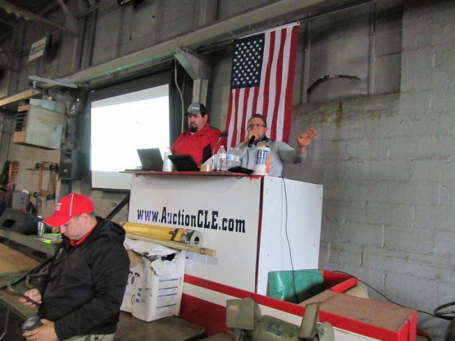 Auction activities were brought into the site's warehouse to avoid the rain.