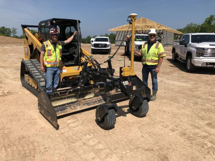Cody Byrd (L), install supervisor of Ideal Landscaping, and Bob Hendrick of SITECH Precision in Raleigh.