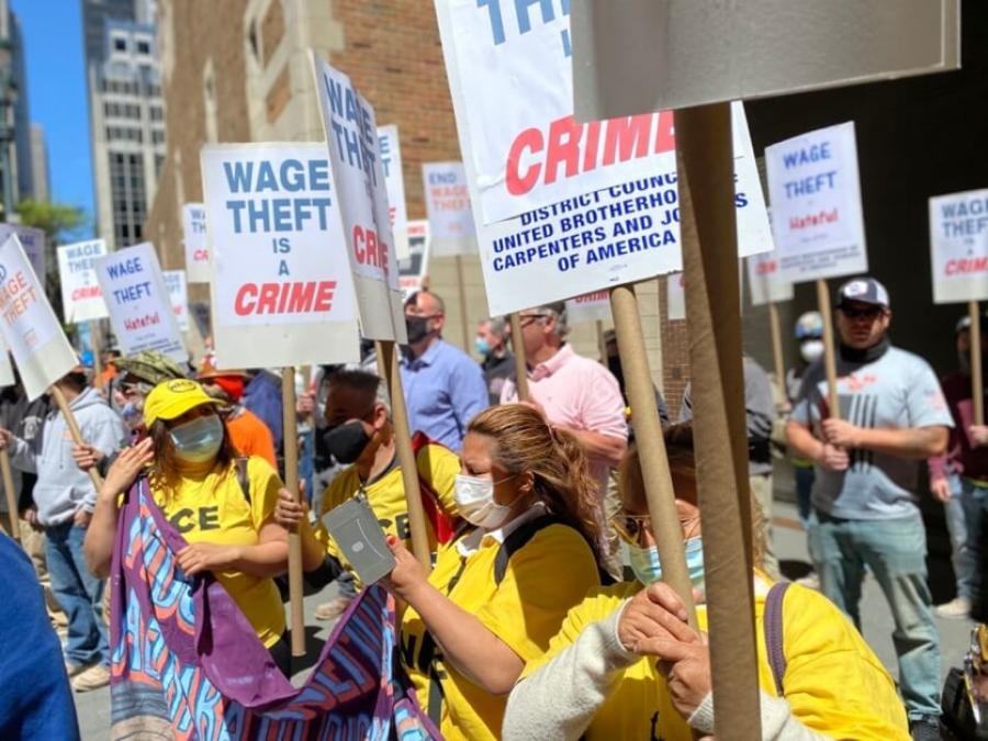 Union members rally outside the Waldorf-Astoria in Manhattan on May 6, 2021, in support of a bill that would combat wage theft in New York state. (NYC District Council of Carpenters photo)