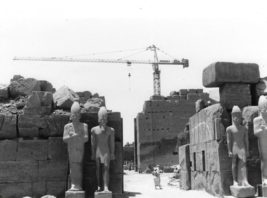 A Potain tower crane at work during rebuilding of a portion of the Karnak Temple in Egypt. (Graham Brent Paper, HCEA Archives photo)