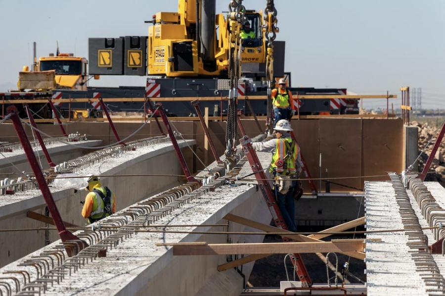 A total of 28 steel-reinforced concrete girders, each weighing approximately 180,000 lbs., were recently lifted into place to provide support for a bridge deck that will carry Loop 303 over Jomax Parkway.