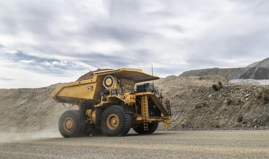 Representing the Caterpillar fleet of autonomous trucks, the displayed Cat 794 AC electric drive will be factory-installed with Cat MineStar Command for hauling.