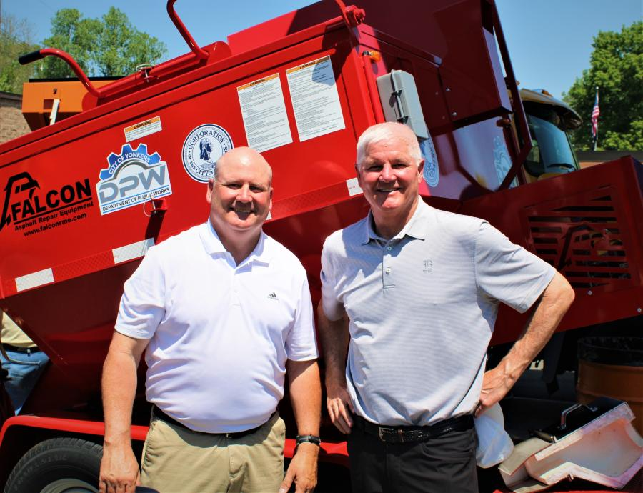 Ray McGrath (L), McGrath Municipal Equipment, and Ric Simon, executive vice president of Falcon, exhibit some of the finest asphalt recycling equipment available.