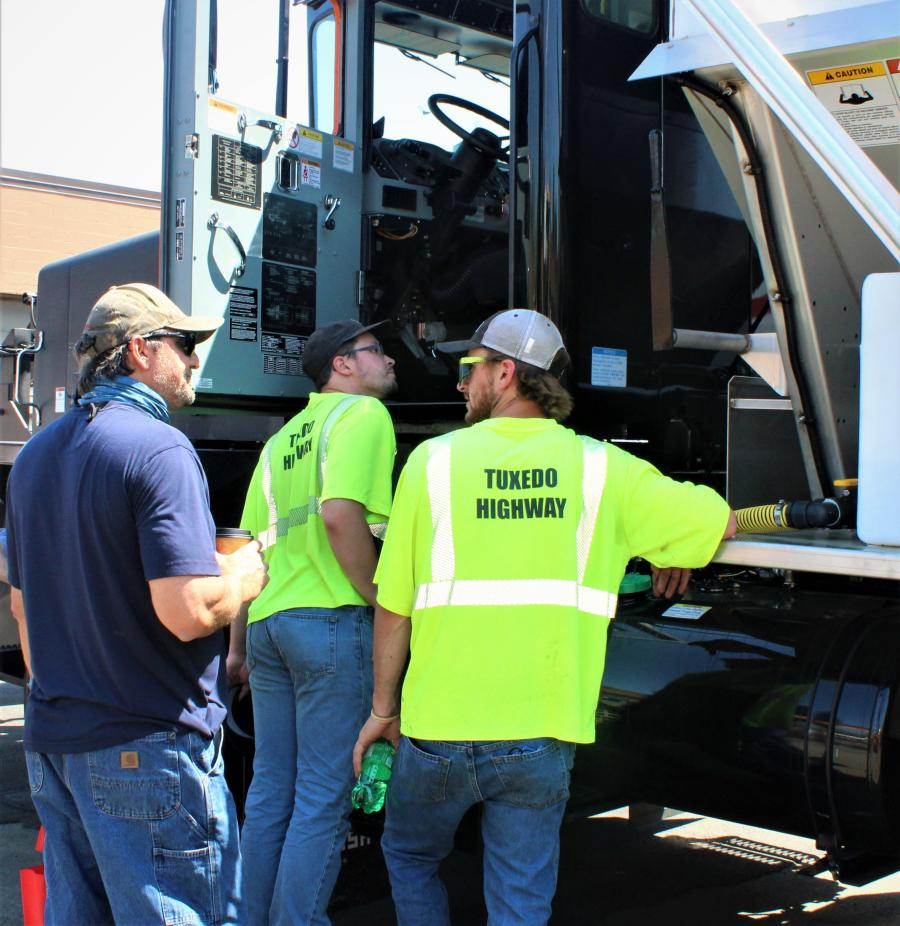 Representatives of the town of Tuxedo highway department check out an Oshkosh truck.