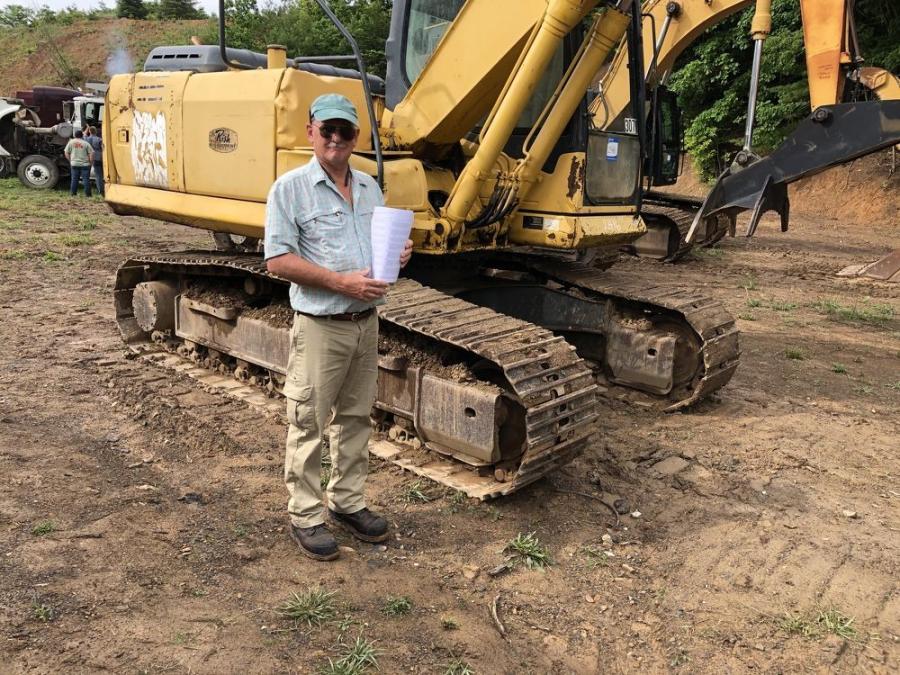 Mike Coburn, of Mechanics Trucks LLC in Princeton, W. Va., took a look at this Komatsu excavator and planned to bid on it.