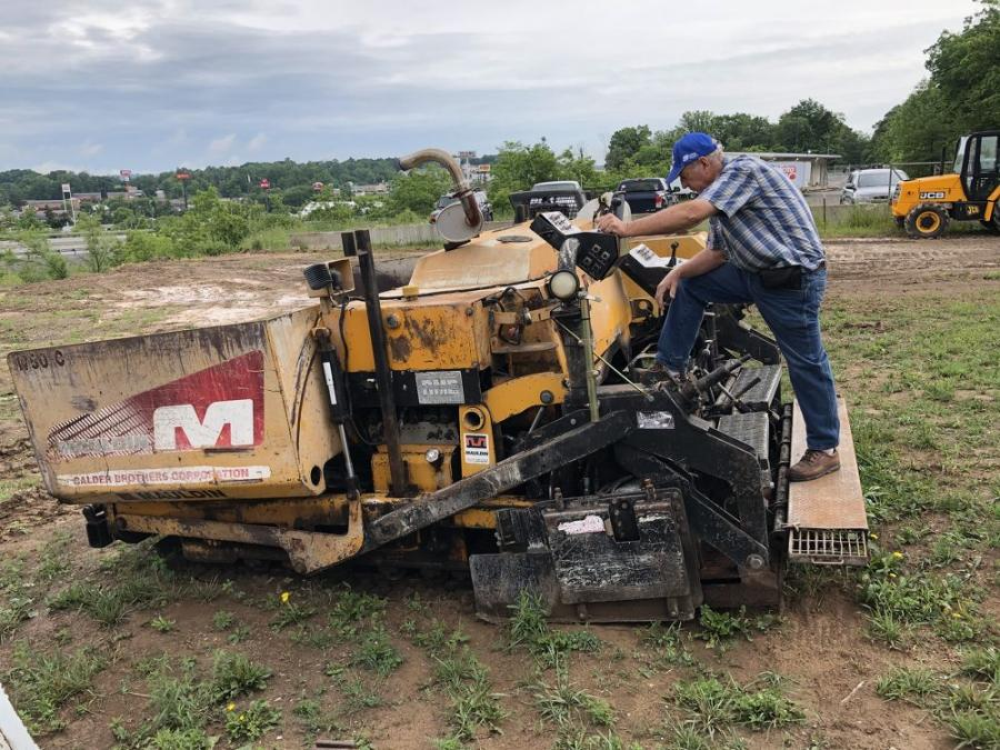 Howard Norton, of Norton Construction in Mars Hill, N.C., looks over this Mauldin 1750C paver.
