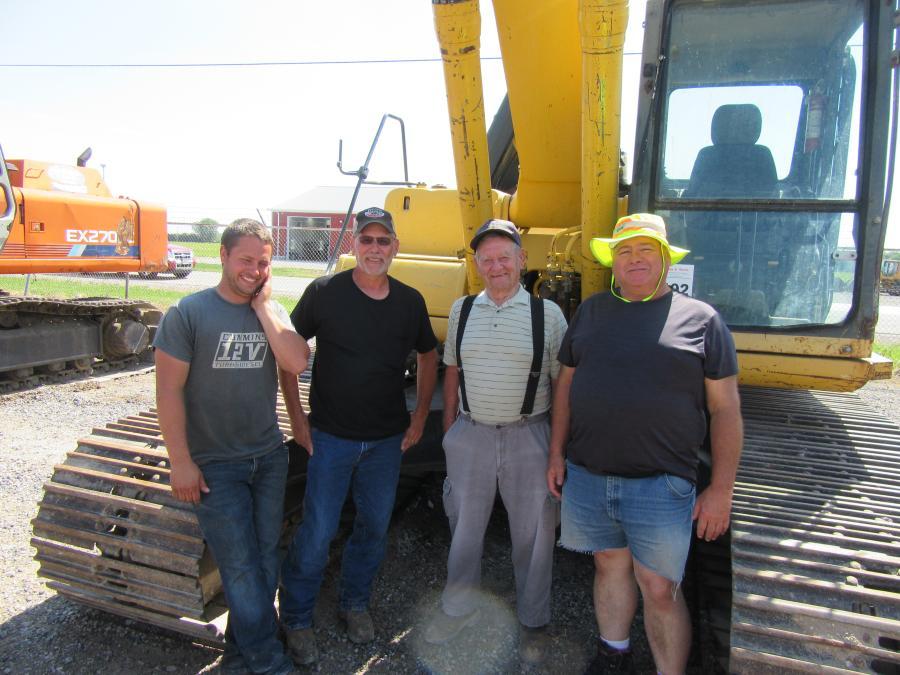 (L-R): Zach Heuerman of Zth Trucking LLC joined Larry Heuerman, Elmer Junge and Dean Miller of Miller Enterprises to review this Komatsu PC 220LC excavator.