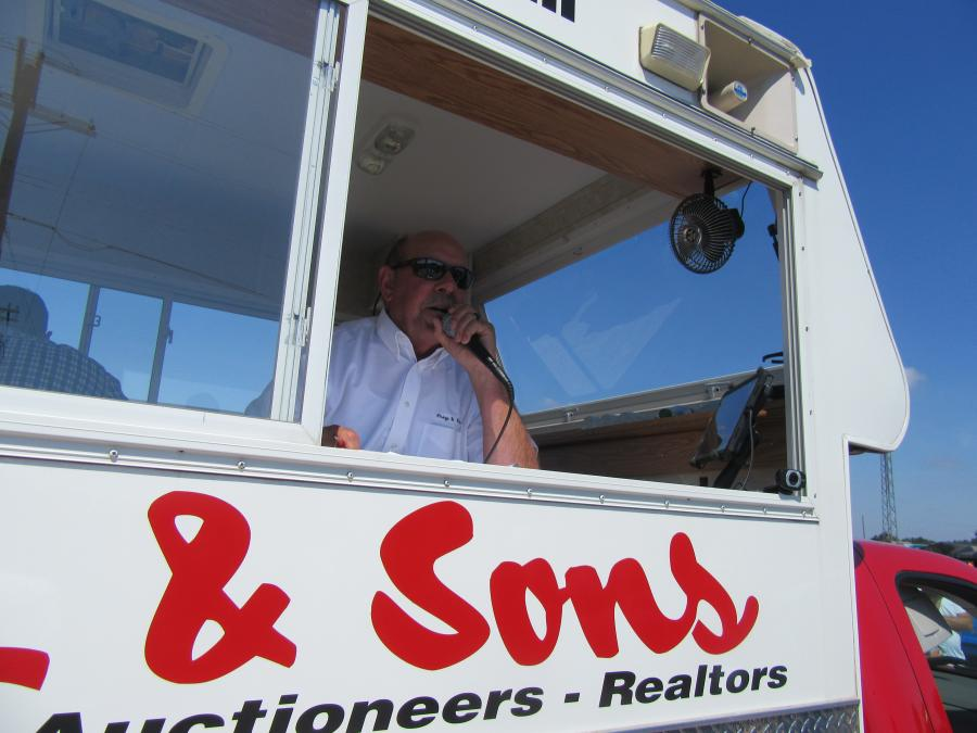 Roger Ford, long-time Frey & Sons Auctioneer, calls out the bids.