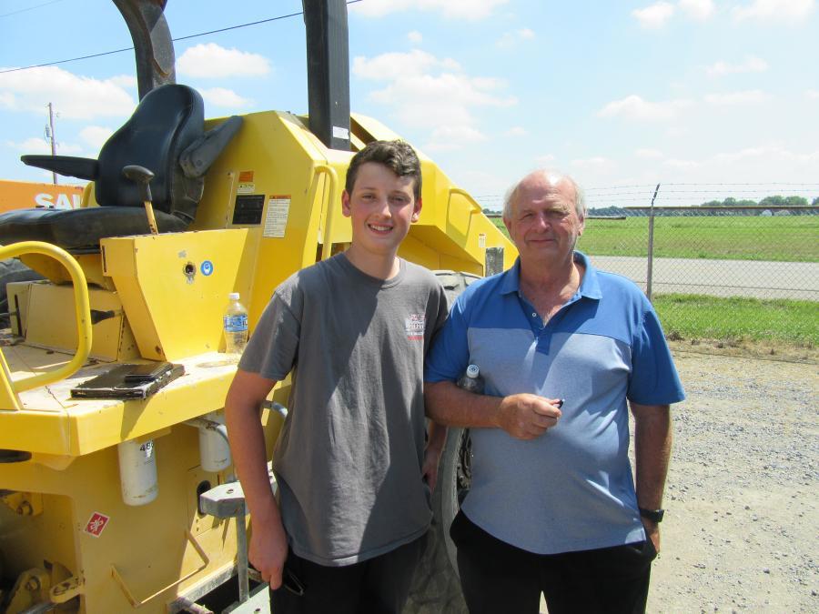 John Bundy (L) and his grandfather, David Bundy, of Bundy Enterprises came in from Pittsburgh to land the winning bid on this Sakai compactor/roller.