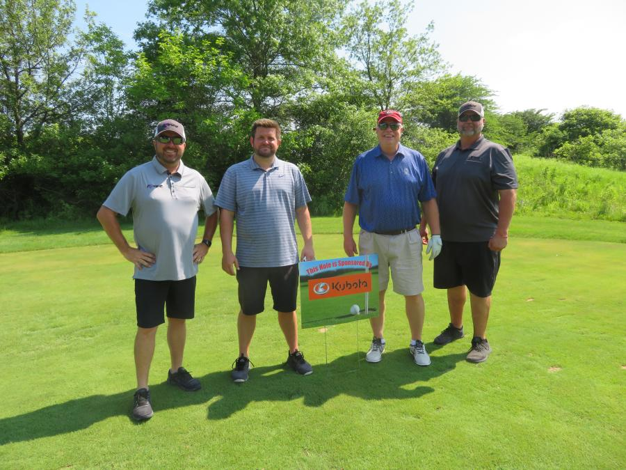 (L-R): Chris O'Connell of K-Tec; Kyle Waller of MEC Aerial; Dave Hubbell MEC Aerial; and Paul Camasto of K-Tec take a time out at the Kubota-sponsored hole.