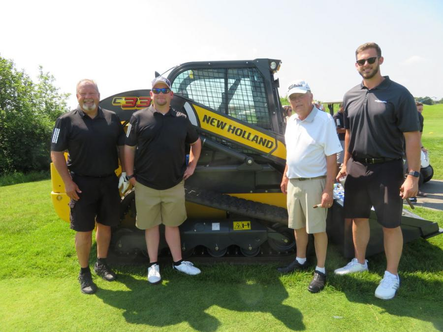 (L-R): Mike Morton, general manager of Alta Equipment Illinois/Indiana; Aaron King of Alta Equipment Co.; Tom Ellis, retired, of the Lanco Group of Companies; and Max Trater, regional business manager of Sennebogen, pause for a picture with this New Holland C337 CTL.