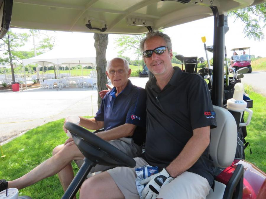 Dave Gorski (L) of K-Five and Tim Stratinsky of Alta Equipment Co. are off to conquer the course in style.