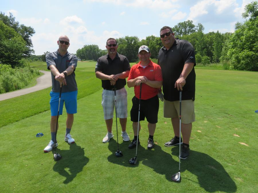 (L-R): Jukka Kytomaki, president of Avant; Gianni Campo, regional vice president of Alta Equipment Co.; Josh Schatzle, JLG's district sales manager of Ohio and Michigan; and Greg Pease, director of sales of Alta Equipment Co., move their offices to the golf course for the day.