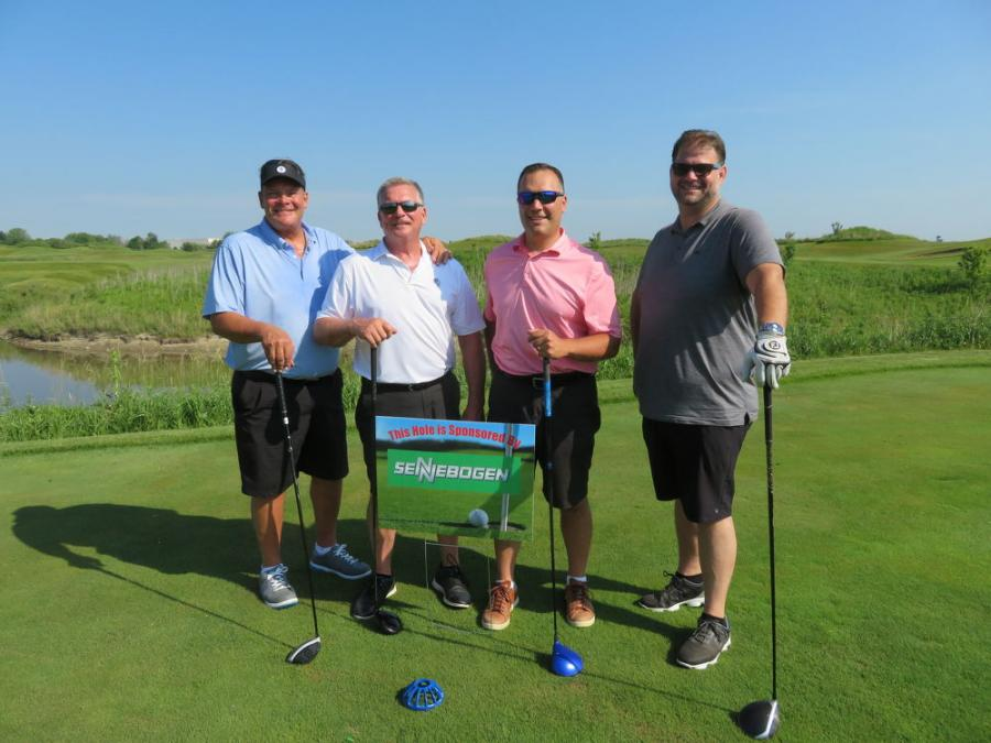 (L-R): David Zanere of Z-Force Transportation; Allen Lindahl of Lindahl Brothers; Shamus Mudron of MKI Insurance; and Josh Zanere of Roy Zanere Trucking and Excavating take a break from the action at the Sennebogen hole.