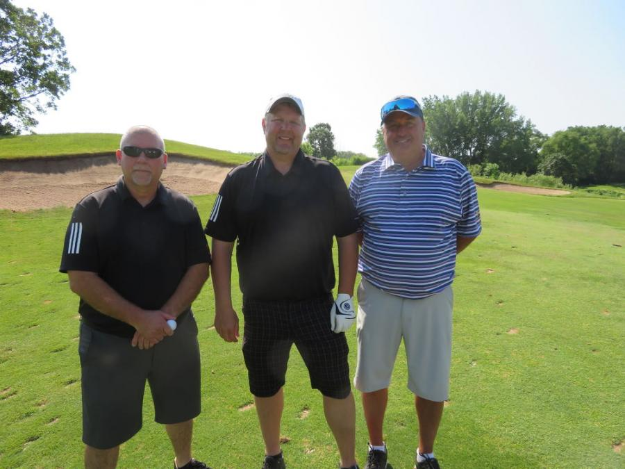 Enjoying the tournament (L-R) are Russ Woelke of Alta Equipment Co.; Mike Garrard of Alta Equipment Co.; and Doug Evans of Genie.