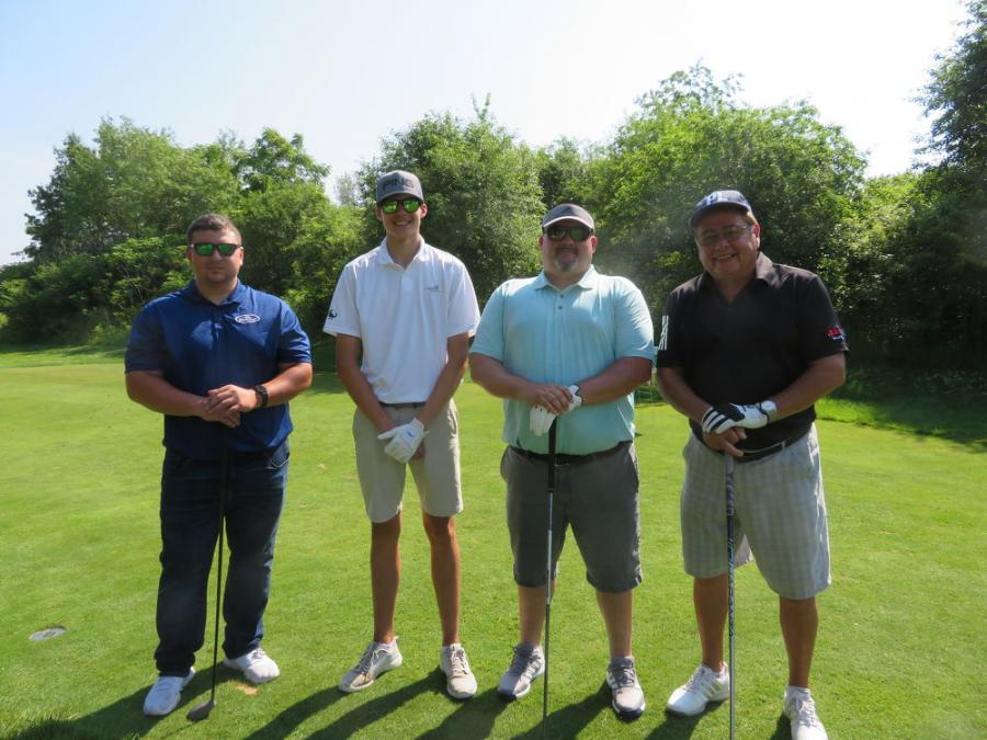 Alta Equipment's Phil Linoski (R) takes to the course with (L-R) Keegan Higgins, Landon Farmer and Steve Farmer, all of Metro Ports.