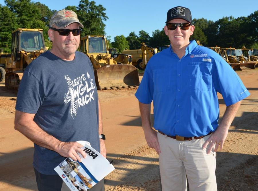 Central Atlanta Tractor's Chuck Spooner (L) and JM Wood's Russ Wood discuss some the machines going on the block on day two of the sale.