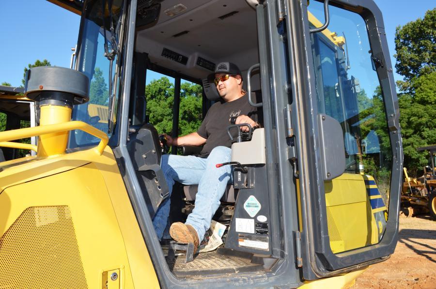 Test operating a Komatsu D39PX is Stephen Harnage of WH Pollard Excavation, Sebring, Fla.