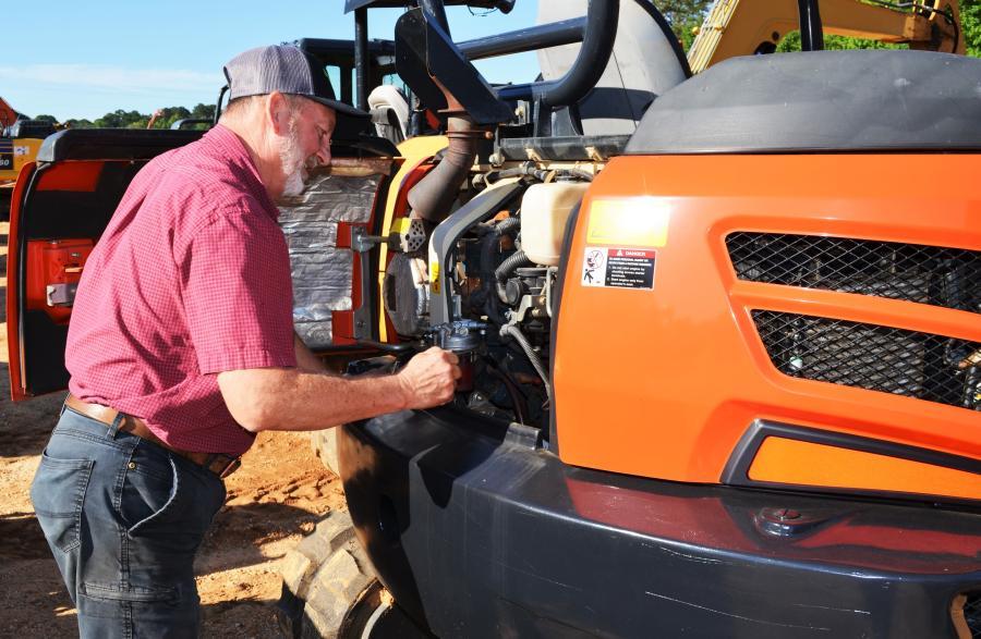 Opening up a Kubota KX057-4 mini-excavator of interest is James Knight of Knight Timber Company, Whigham, Ga.