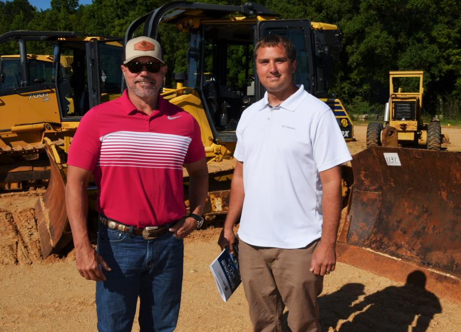 JB Dunn (L) and Chris Benefield of Landworks, Heflin, Ala., were interested in some of the dozers about to go on the auction block.