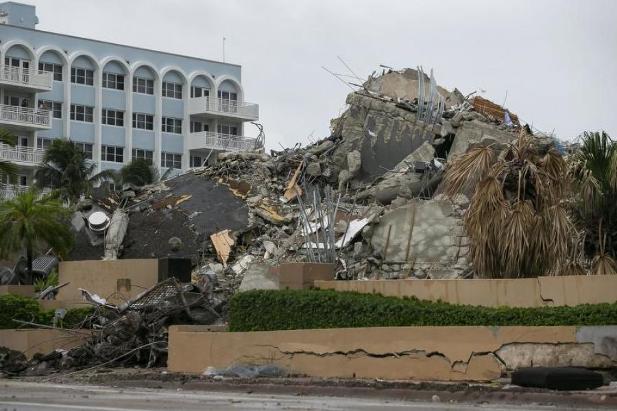 Rubble and debris of the Champlain Towers South condo can be seen Tuesday, July 6, 2021 in Surfside, Fla.  (Carl Juste/Miami Herald via AP)