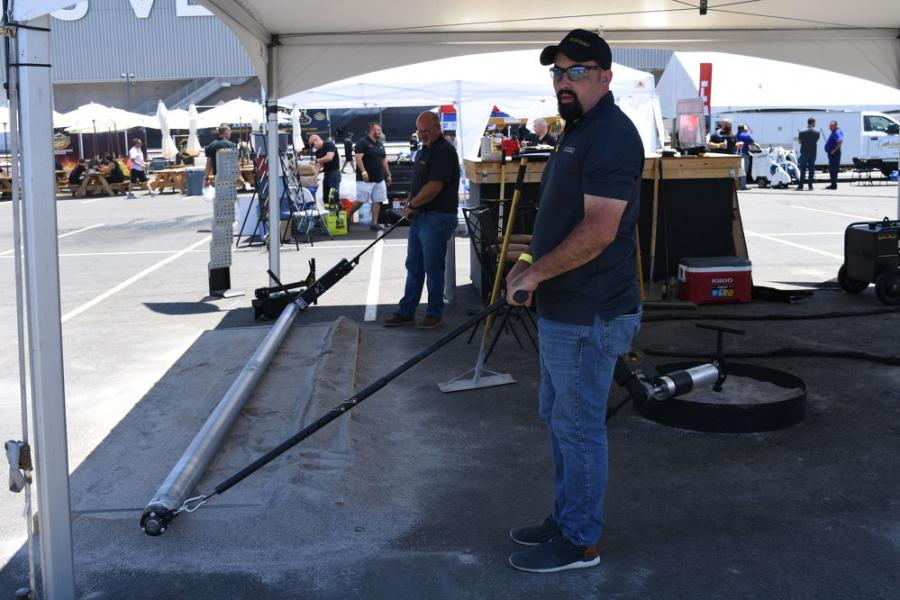 Representatives from Curb Roller show off their latest offerings at the World of Concrete.