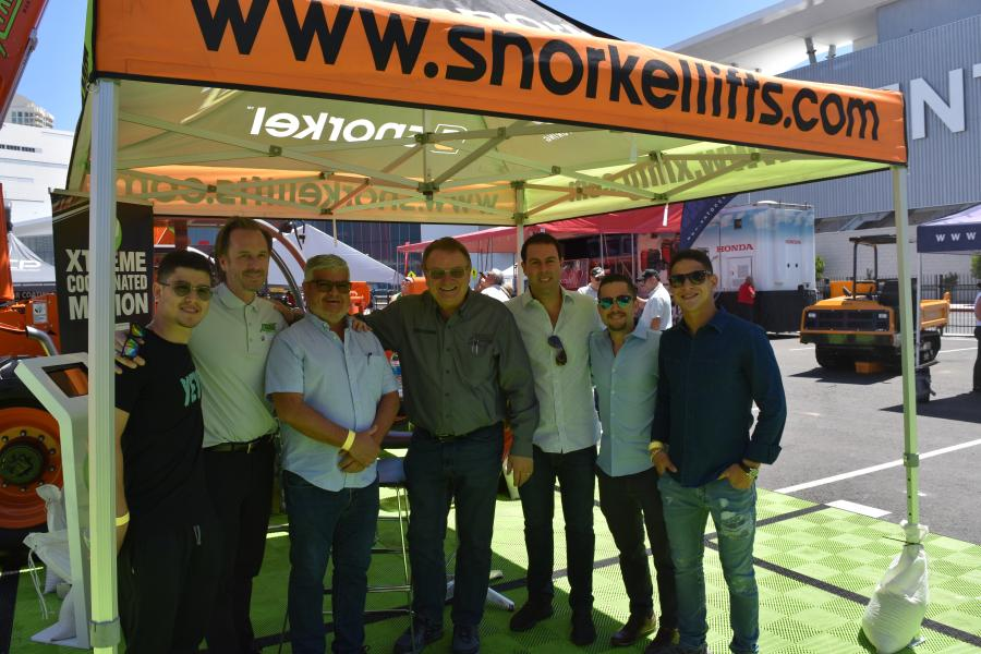 Brody McFarland (second from L), Xtreme Manufacturing & Snorkel salesman, Latin America; and Don Ahern (fourth from L), owner of Xtreme Manufacturing & Snorkel, pose with interested customers.