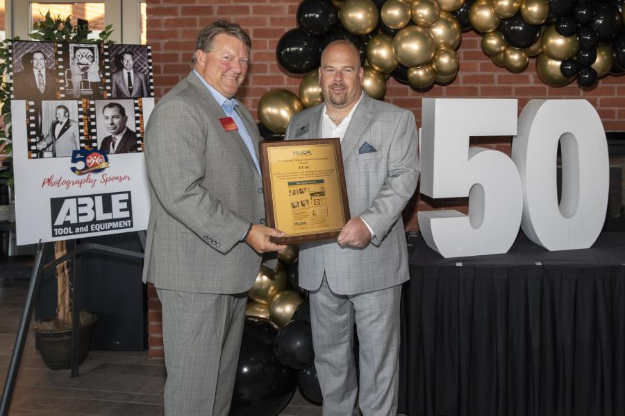 NUCA CEO Doug Carlson (L) presented a plaque to UCAC's Immediate Past President Kevin Plourde, D & G Contractors.