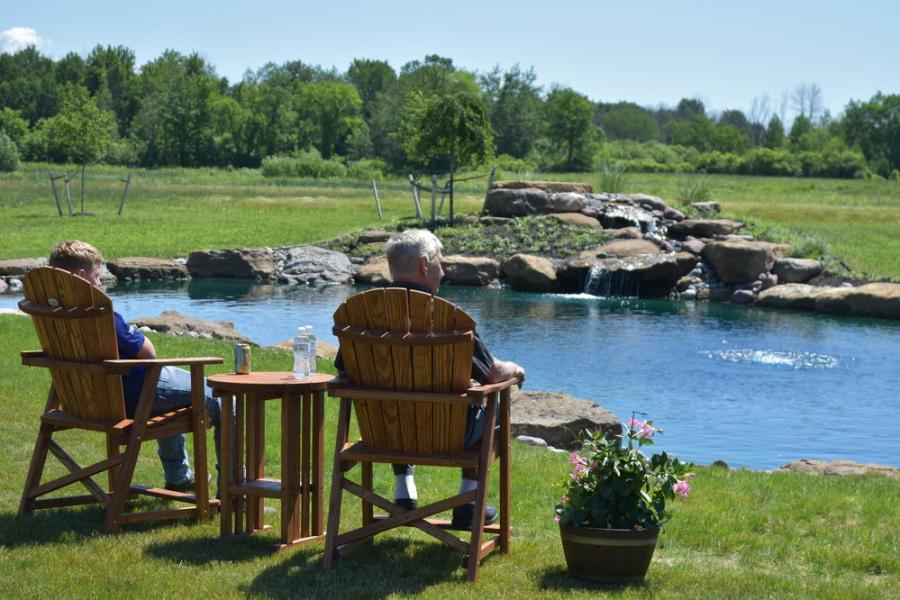Visitors were encouraged to take a load off their feet, relax and enjoy the view by the J & J goldfish pond.