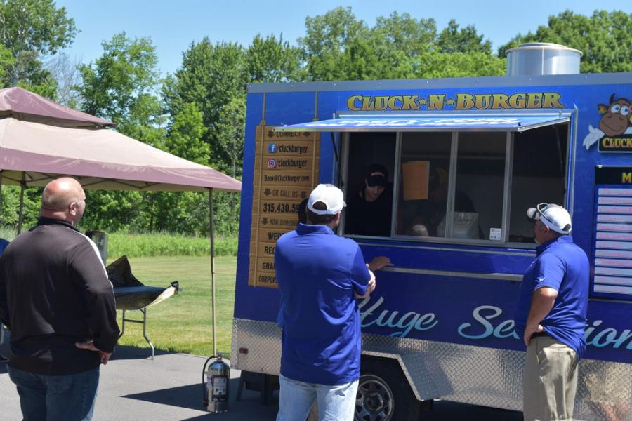 Lunch from the Cluck N Burger food truck, complements of J & J Equipment.