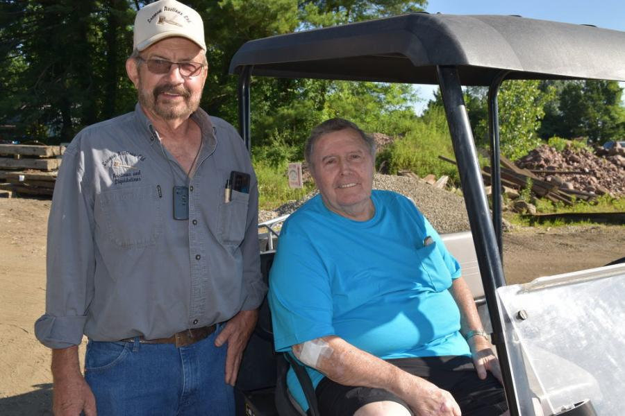 Ed Leaman (L), president and founder of Leaman Auctions Ltd, takes time for a photo with Richard Giberson, owner of Giberson Plumbing & Excavating Co., moments before the liquidation of Giberson's 60-plus year excavating business.