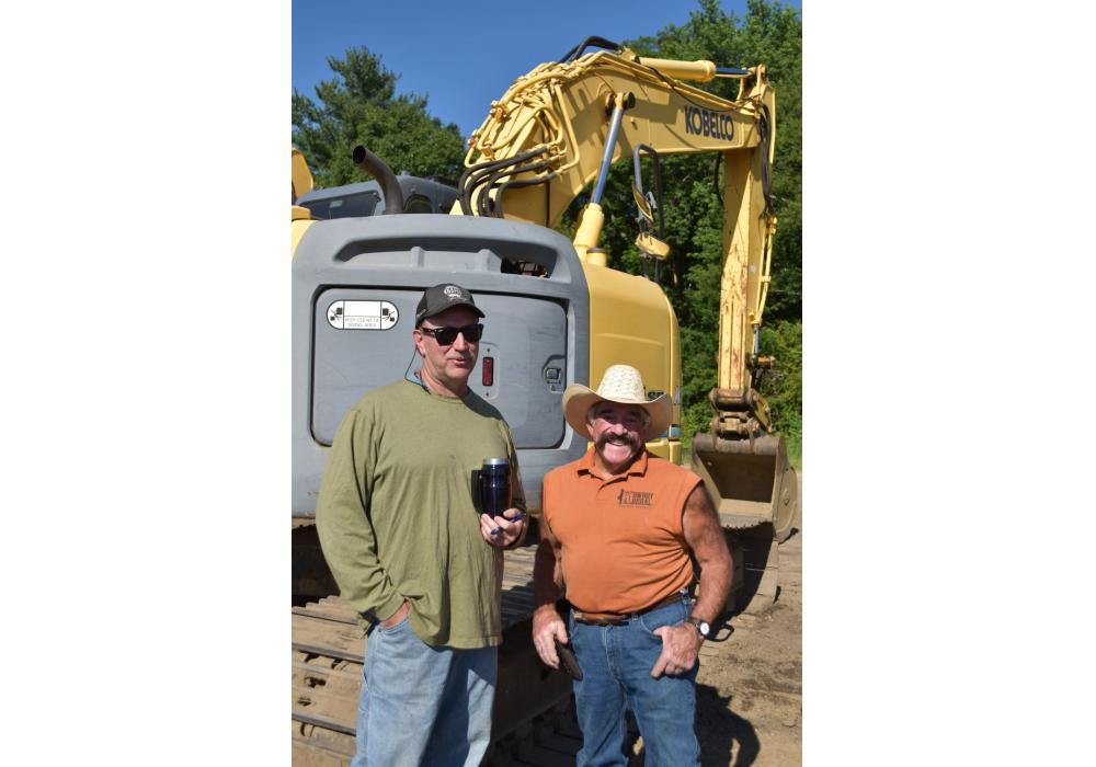 Mike Finnegan (L) of Artistic Materials in Southampton, N.J., and Buddy Pino of Buddy Pino Construction in Green Bank, N.J., stopped to chat by one of the many Kobelco excavators featured in the sale.