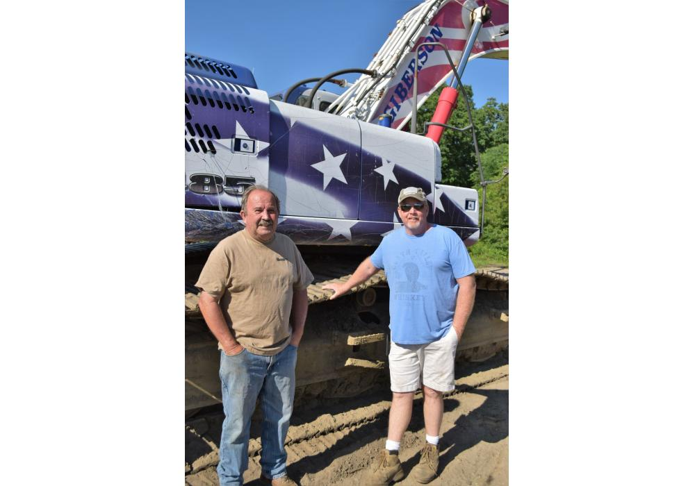 Ken Gower (L) of Gowers Construction in Southampton, N.J., and John Redman of Redman Landscaping in Southampton, N.J., check out the special Stars & Stripes Kobelco excavator.